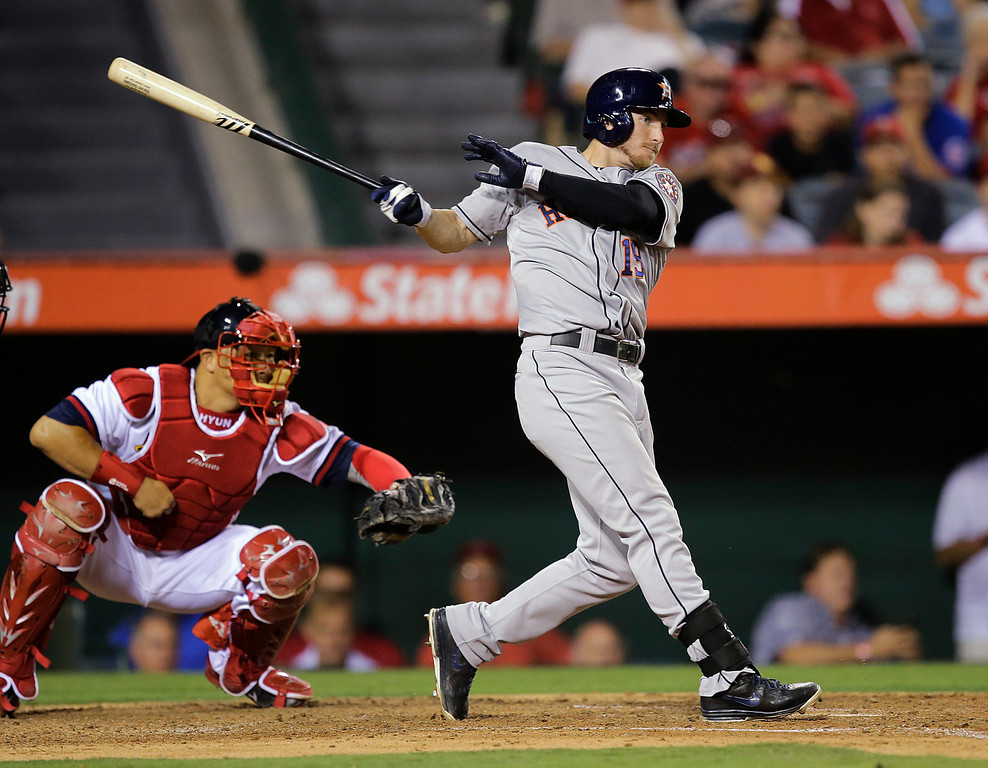 . Houston Astros\' Robbie Grossman hits a RBI single during the fifth inning of a baseball game against the Los Angeles Angels on Friday, Aug. 16, 2013, in Anaheim, Calif. (AP Photo/Jae C. Hong)