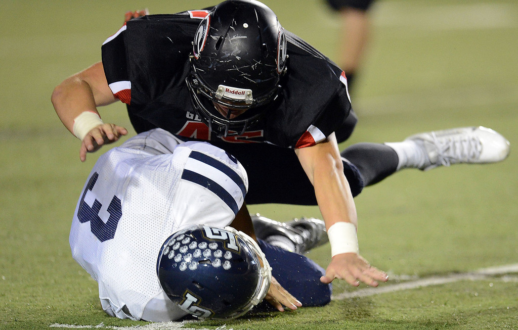 . Glendora\'s Justin Frazier sacks Los Osos quarterback Jason Crain (3) for a 9 yard loss in the first half of a prep football game at Citrus College in Glendora, Calif., on Thursday, Oct. 31, 2013.    (Keith Birmingham Pasadena Star-News)