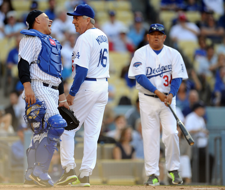 . Former Los Angeles Dodgers Rick Monday shares a laugh with former New York Yankee Jim Leyritz during the Old-Timers game prior to a baseball game between the Atlanta Braves and the Los Angeles Dodgers on Saturday, June 8, 2013 in Los Angeles.   (Keith Birmingham/Pasadena Star-News)