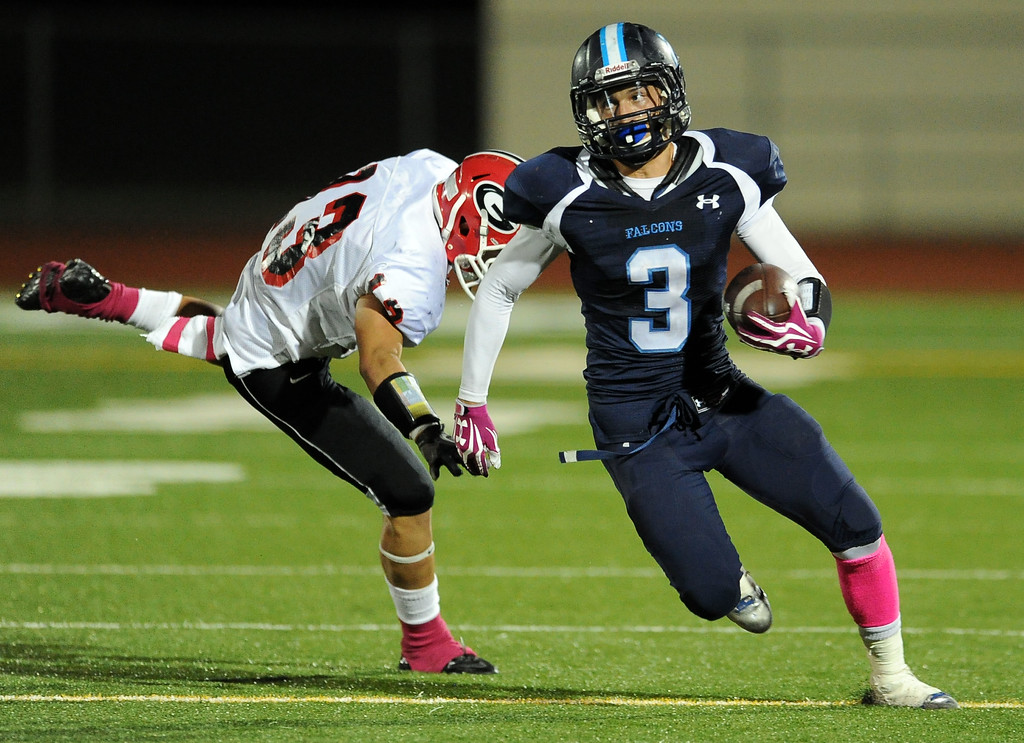 . Duarte\'s Nick Leon (3) runs past Gladstone\'s Jakeob Sedano (23) for a first down in the first half of a prep football game at Duarte High School in Duarte, Calif., Thursday, Oct. 10, 2013.    (Keith Birmingham Pasadena Star-News)