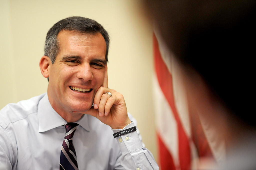 . Mayor Eric Garcetti meets with a constituent Monday during his first day as Mayor of Los Angeles.   Garcetti held �office hours� at City Hall from 2-5 p.m., during which he met with Angelenos who have emailed requests for help from City Hall July 1, 2013.(Andy Holzman/Los Angeles Daily News)