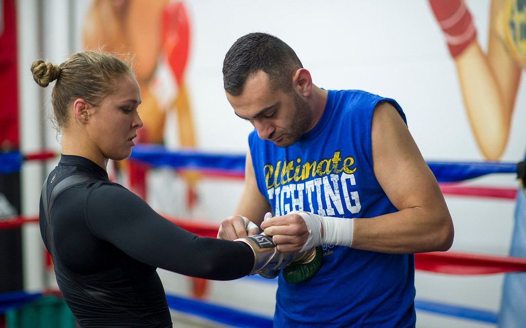 . Members of the media watch UFC women\'s bantamweight champion Ronda Rousey  and coach Edmond Tarverdyan  during open workout at Glendale Fighting Club in Glendale Monday, February 10, 2014. (Photo by Hans Gutknecht/Los Angeles Daily News)