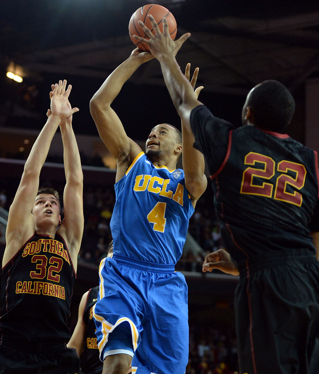 . UCLA\'s Norman Powell (4) shoots between Southern California\'s Nikola Jovanovic (32) and Byron Wesley (22) in the first half of a PAC-12 NCAA basketball game at Galen Center in Los Angeles, Calif., on Saturday, Feb. 8, 2014. (Keith Birmingham Pasadena Star-News)