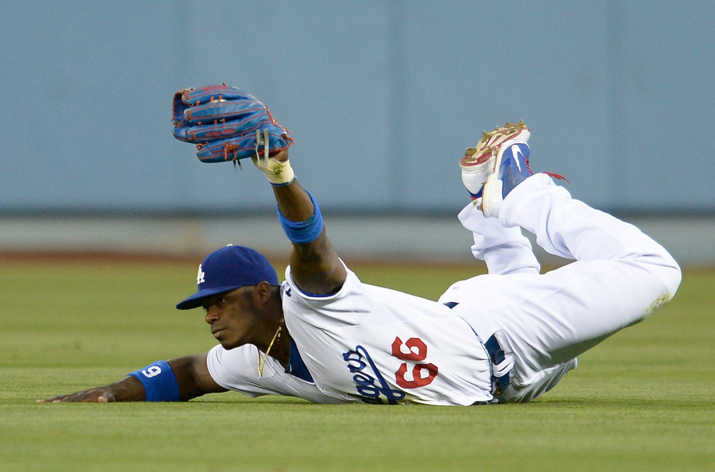 . Yasiel Puig makes a diving catch in the 4th inning. The Dodgers played the Colorado Rockies at Dodger Stadium in Los Angeles, CA. 6/18/2014(Photo by John McCoy Daily News)