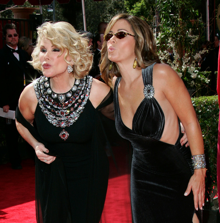 . Joan Rivers and her daughter, Melissa, from the TV Guide Channel, blow kisses as they arrive for the 57th Annual Primetime Emmy Awards Sunday, Sept. 18, 2005, at the Shrine Auditorium in Los Angeles.  (AP Photo/Kevork Djansezian)