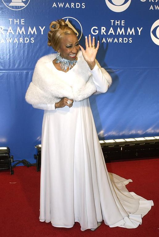 . Cuban salsa star Celia Cruz arrives at the 45th Annual Grammy Awards, Sunday, Feb. 23, 2003, in New York. (AP Photo/Mark J. Terrill)