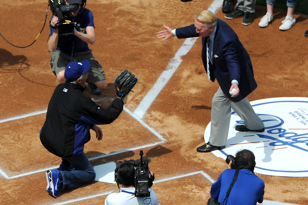 . Dodger announcer Vin Scully, with his grandchildren behind, greets Sandy Koufax for the first pitch at the Dodgers home opener, Friday, April 4, 2014, at Dodger Stadium. (Photo by Michael Owen Baker/L.A. Daily News)
