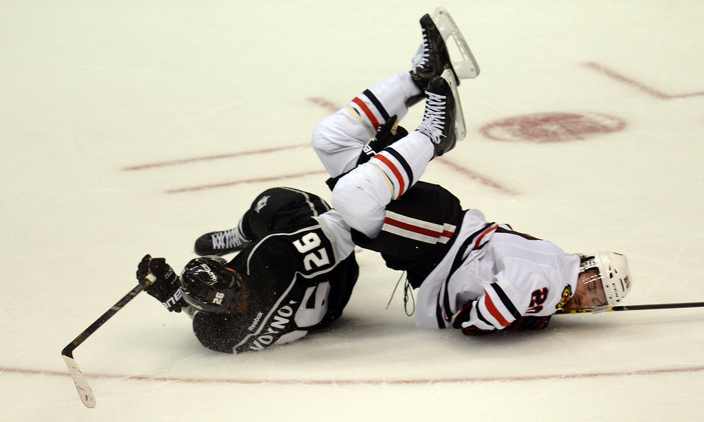 . The Blackhawks� Brandon Saad #20 is upended by the Kings� Slava Voynov #26 during Game 6 of the Western Conference finals at the Staples Center on Friday, May 30, 2014. The Blackhawks beat the Kings 4-3. (Photo by Hans Gutknecht/Los Angeles Daily News)
