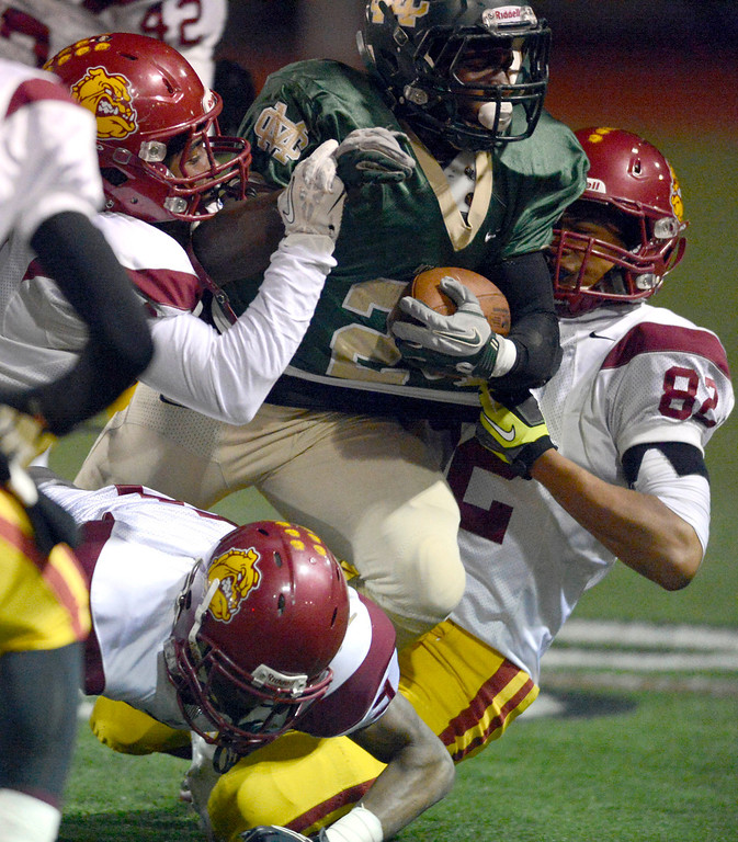 . Costa running back Sebastian Franck-Love breaks through the Highland defense in  first-half game action in the CIF Southern Section Northern Division first-round football game between the Highland High School Bulldogs and Mira Costal Mustangs at Costa Friday evening, 11/15/2013.  Photo for The Daily Breeze by Axel Koester, 11/15/2013.
