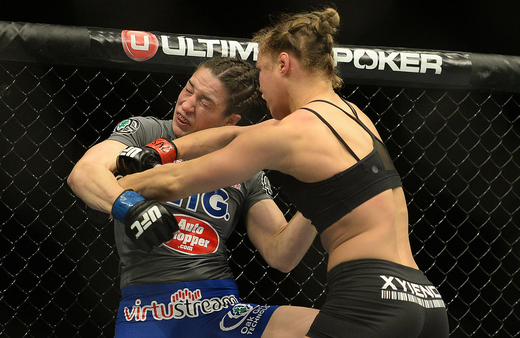 . UFC women\'s bantamweight champion Ronda Rousey right hook to the head of Sara McMann during  UFC 170 at the Mandalay Bay Events Center in Las Vegas February 22, 2014. Rousey defeated McMann by referee stoppage in the first round. (Photo by Hans Gutknecht/Los Angeles Daily News)