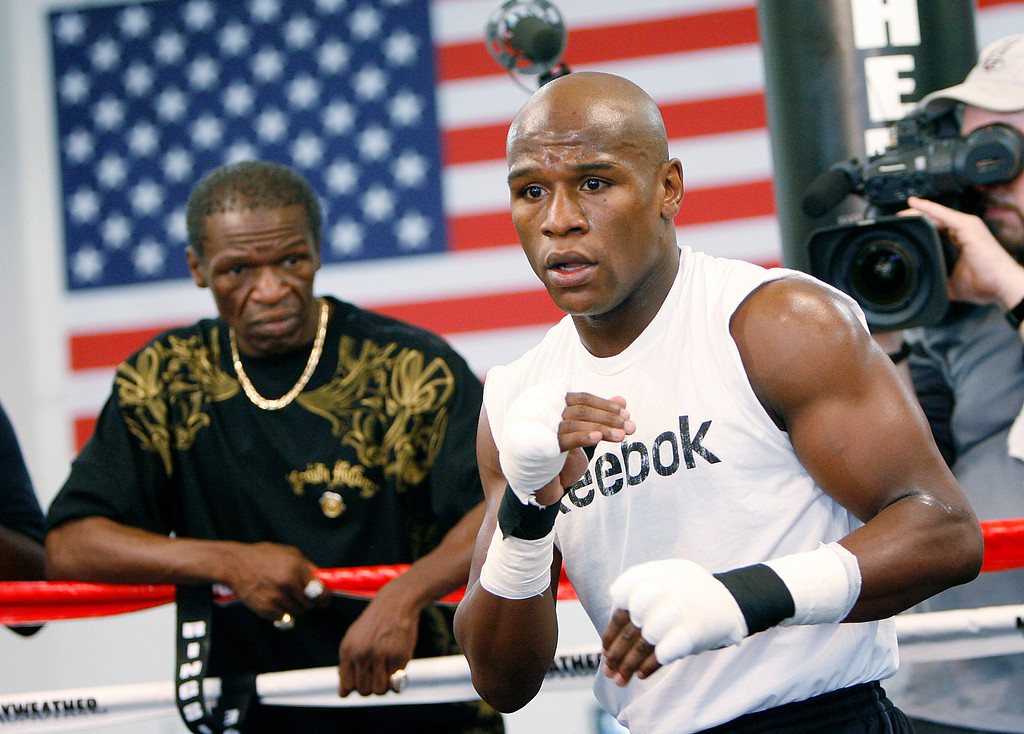 . Floyd Mayweather Jr., right, works out at his gym as his father, Floyd Mayweather Sr., left, looks on Wednesday, Sept. 2, 2009 in Las Vegas. Mayweather will box Juan Manuel Marquez Sept. 19, 2009 at the MGM Grand Garden Arena. (AP Photo/Isaac Brekken)