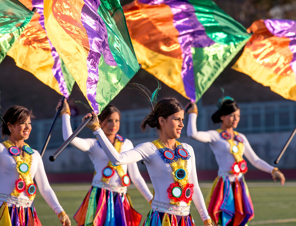 . Flag twirlers of the Banda de Musico Herberto Lopez Colegio of Panama perform during the Pasadena Tournament of Roses Bandfest I at Pasadena City College Dec. 29, 2013.   (Staff photo by Leo Jarzomb/Pasadena Star-News)