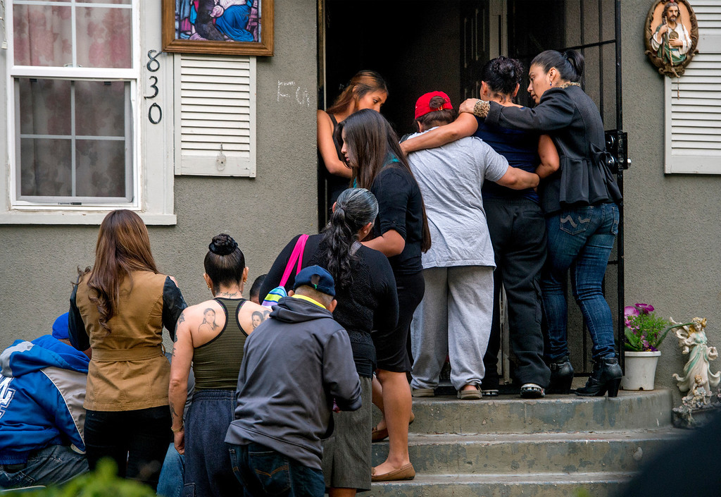 . Relatives, friends and neighbors mourn the death of Irais Acosta, 19, with a memorial at her mother\'s Garfield Avenue home in Pasadena, Calif. Feb. 17, 2014.  (Staff photo by Leo Jarzomb/Pasadena Star-News)