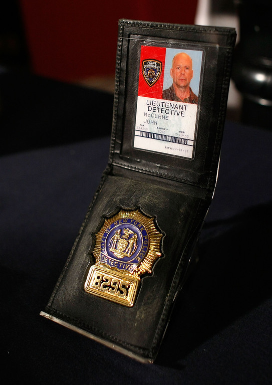 ". WASHINGTON - JUNE 27:  The badge used as a prop by actor Bruce Willis in the ""Die Hard\"" series of films is shown at the Smithsonian\'s National Museum of American History June 27, 2007 in Washington, DC. A selection of \""Die Hard\"" items will go on display in the new acquisitions case in the museum\'s \""Treasures of American History\"" exhibition at the Smithsonian.  (Photo by Win McNamee/Getty Images)"