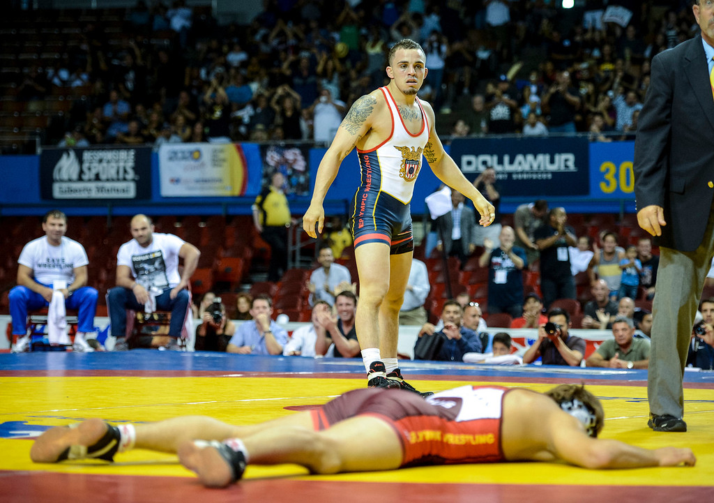 . The USA\'s  Jordan Oliver leaves Russian Rasul Dzhukaev on the mat as he defeated the Russian at the USA vs Russia vs Canada dual meet at the Sports Arena Sunday .  Photo by David Crane/Los Angeles Daily News.
