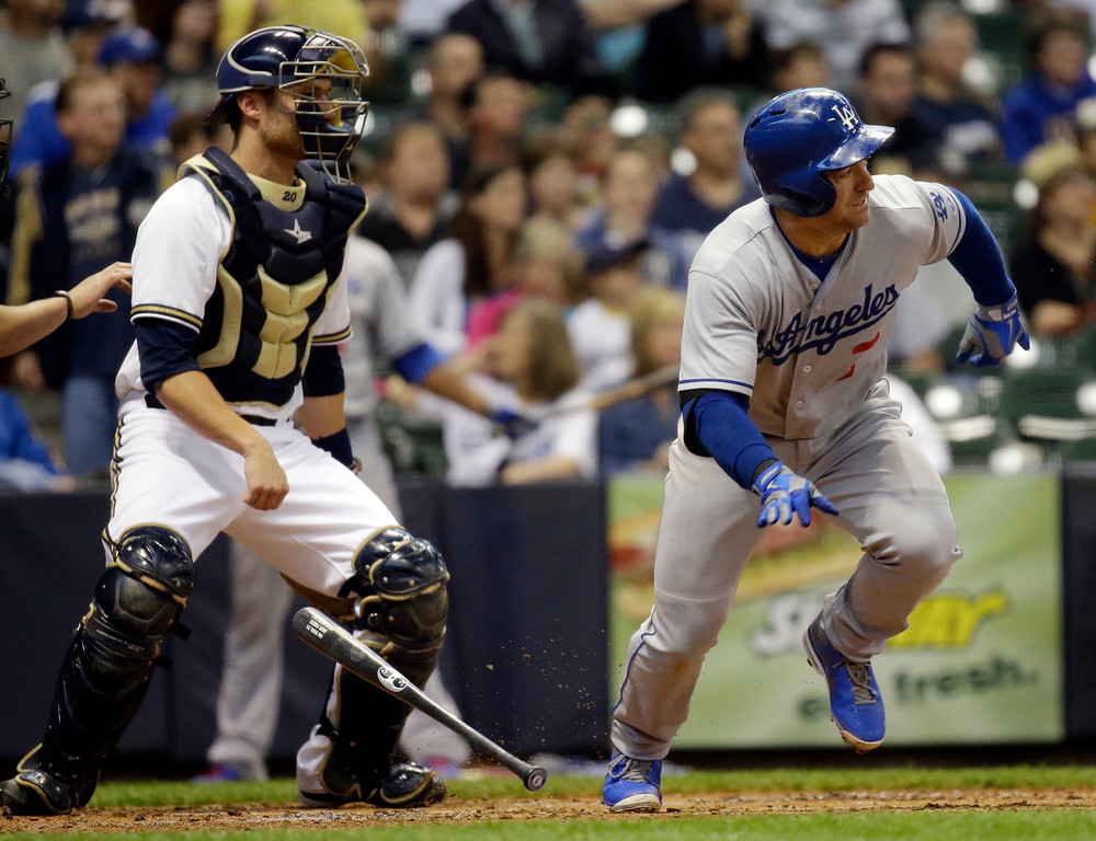 . Los Angeles Dodgers\' JNick Punto hits a single during the second inning of a baseball game against the Milwaukee Brewers Wednesday, May 22, 2013, in Milwaukee. (AP Photo/Morry Gash)