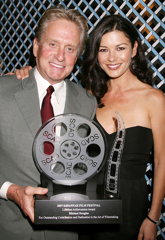 . In this photo provided by the Savannah College of Art and Design (SCAD), actor Michael Douglas and his wife actress Catherine Zeta-Jones attend the opening night of the Savannah Film Festival Saturday, Oct. 27, 2007 where Douglas received the Lifetime Achievement Award for his outstanding contribution and dedication to the art of film making.  (AP Photo/SCAD, Dave Allocca,)