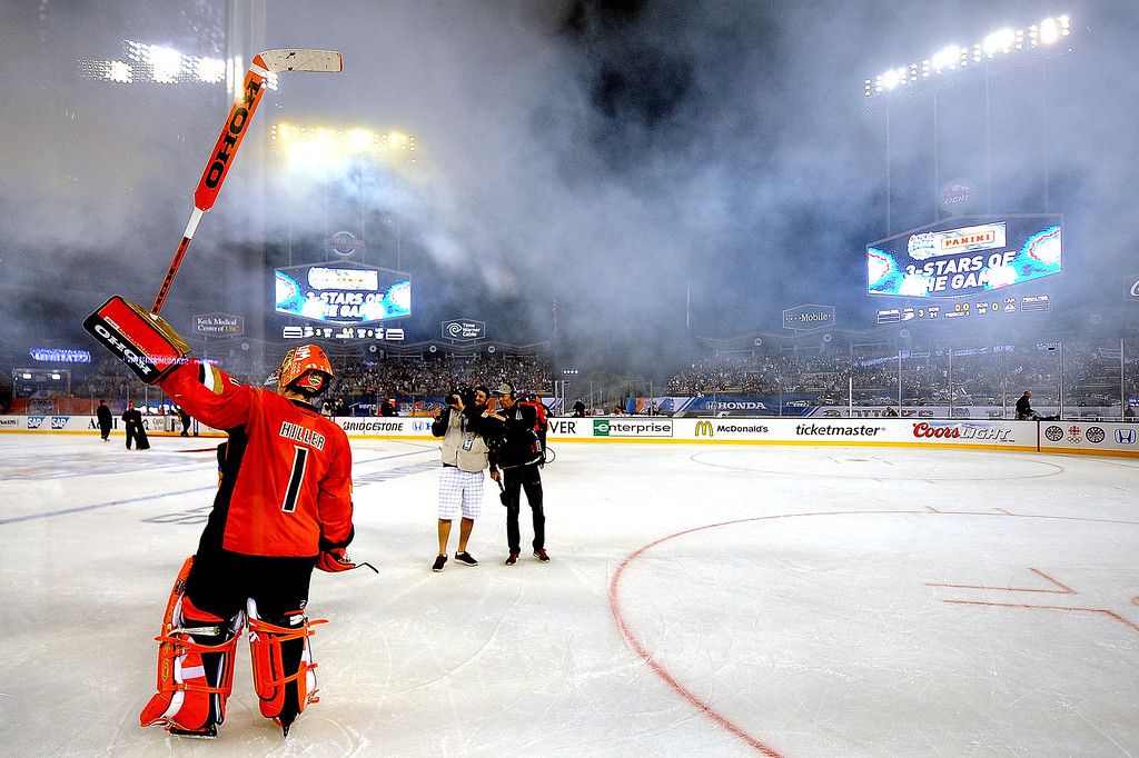 . Anaheim Ducks goalie Jonas Hiller holds his stick-up to the crowd after defeating the Los Angeles Kings 3-0 and bing named one of the stars of the game during the inaugural NHL Stadium Series game at Dodger Stadium in Los Angeles on Saturday, Jan. 25, 2014. (Keith Birmingham Pasadena Star-News)