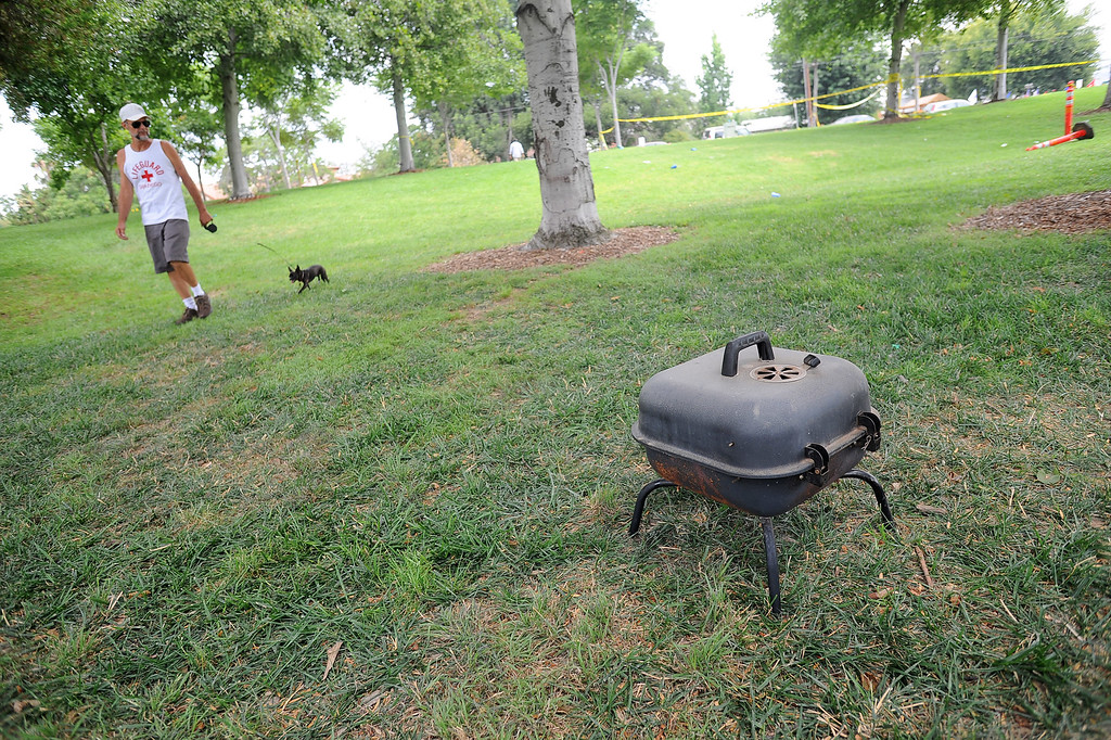 . A BBQ is left behind after a Fourth of July fireworks show mishap injured 28 people at Rancho Santa Susana Community Park in Simi Valley, CA July 5, 2013.     (Andy Holzman/Los Angeles Daily News)