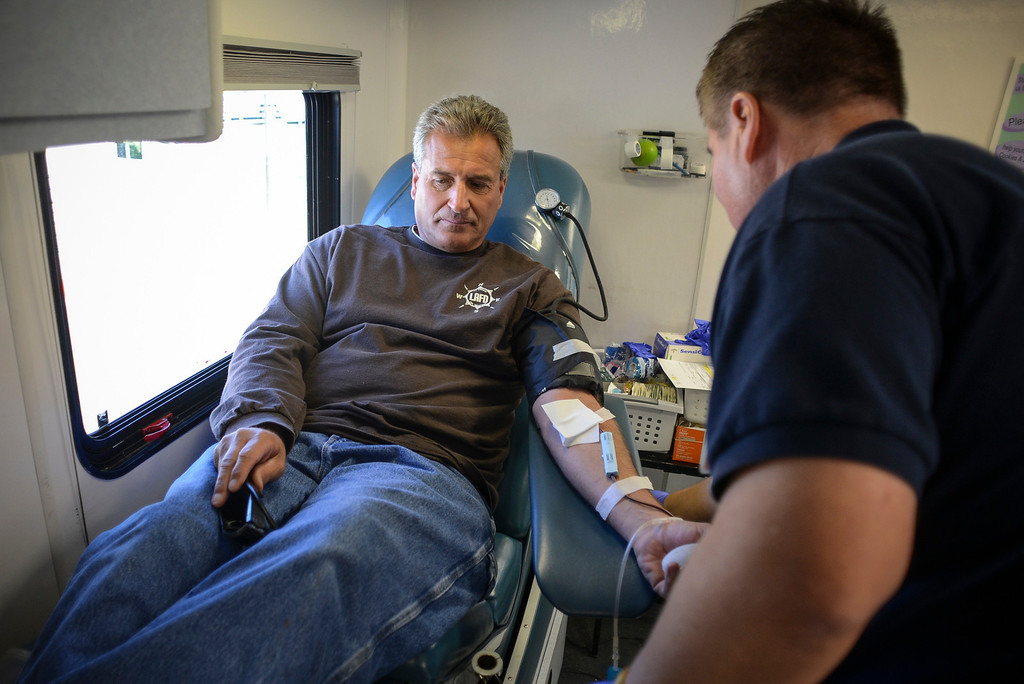 . Loa Angeles city firefighter Greg Pascolla gives blood at Providence Holy Cross Medical Center in Mission Hills Monday, April 7, 2014.  The blood drive was held for the LAPD motor officer who was involved in a crash over the weekend and remains in critical condition at the hospital.    (Photo by David Crane/Los Angeles Daily News.)