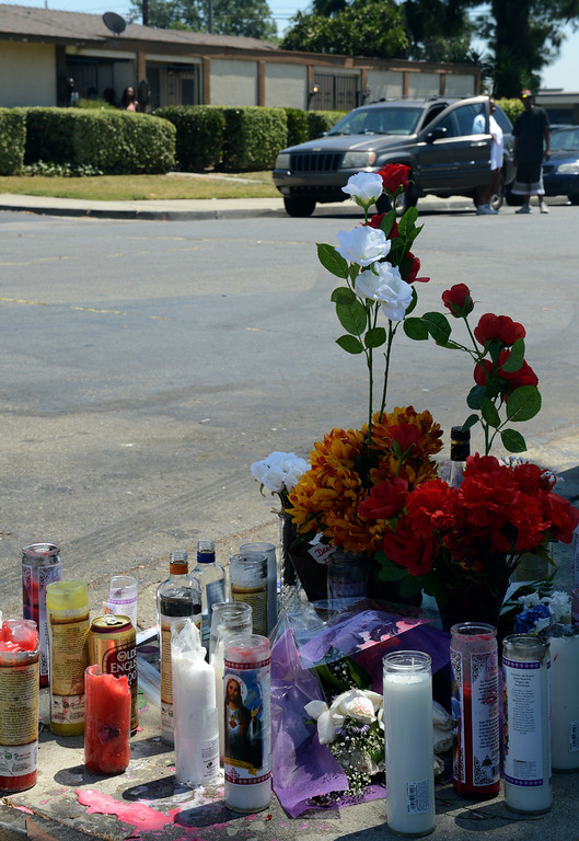 . A memorial for Angel Bravo Monday, August 12, 2013, in the 1700 block of Benedict Way in Pomona. Bravo, 29, was shot and killed while standing near his vehicle early Sunday morning.  Jennifer Cappuccio Maher/Staff Photographer