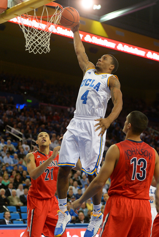 . UCLA\'s Norman Powell goes for a dunk in the first half against Arizona, Thursday, January 9, 2014, at Pauley Pavilion. (Photo by Michael Owen Baker/L.A. Daily News)