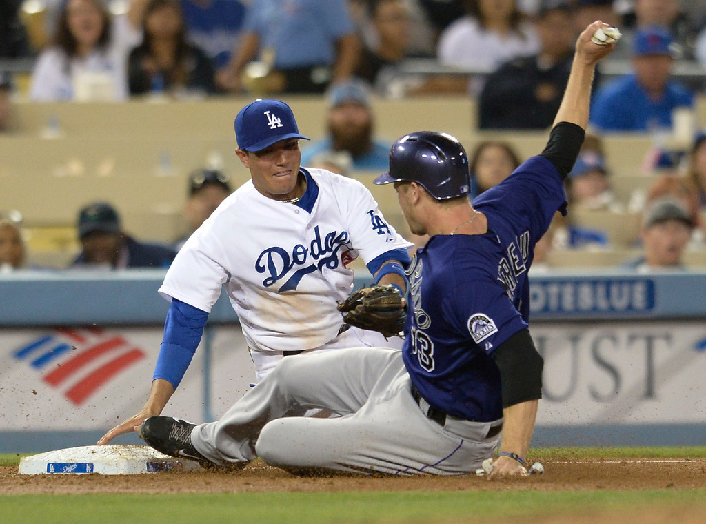 . Rockies Justin Morneau beats the throw to 3rd base while Miguel Rojas is late with the tag in the 6th inning. The Dodgers defeated the Colorado Rockies at 4-2 Dodger Stadium in Los Angeles, CA. 6/18/2014(Photo by John McCoy Daily News)