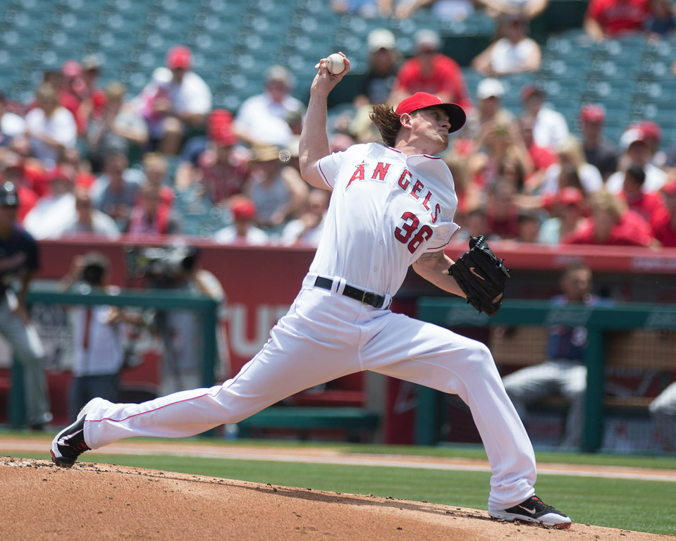 . Angels pitcher Jered Weaver (#36) makes a pitch in the first inning against the Minnesota Twins at Angel Stadium in Anaheim on Thursday June 26, 2014. (Photo by Keith Durflinger/Whittier Daily News)