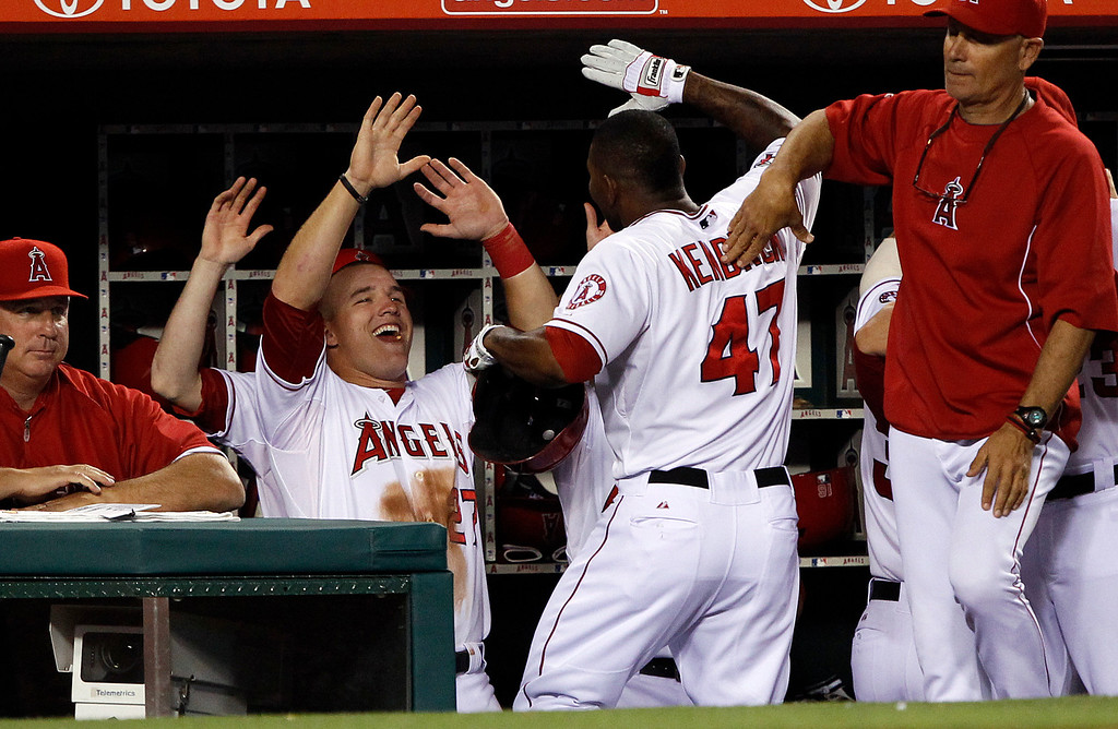 . Los Angeles Angels\' Mike Trout, second from left, congratulates Angels\' Howie Kendrick (47) for hitting a two-run home run in the fourth inning against the Seattle Mariners during a baseball game Tuesday, May 21, 2013 in Anaheim.    (AP Photo/Alex Gallardo)