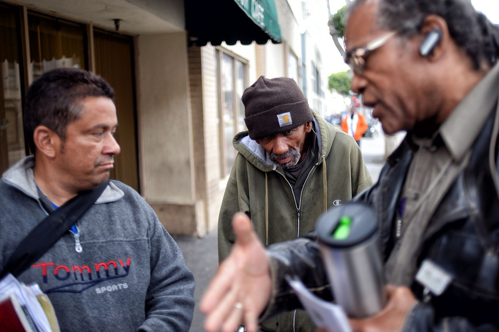 . JWCH Institute Lead Community Outreach Worker Christopher Mack  talks to Fernie Chaffino and Phillip Evan about health care in the Skid-row area of Los Angeles Wednesday, April 24, 2013. (Hans Gutknecht/Staff Photographer)