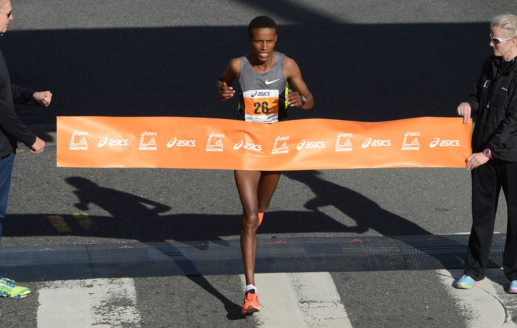 . 2014 ASICS LA Marathon men\'s winner Gebo Burka of Ethiopia, celebrates crosses the finish line in Santa Monica Calif, with a time of 2: 10: 37.   Sunday, March 9,  2014.   (Photo by Stephen Carr / Daily Breeze)