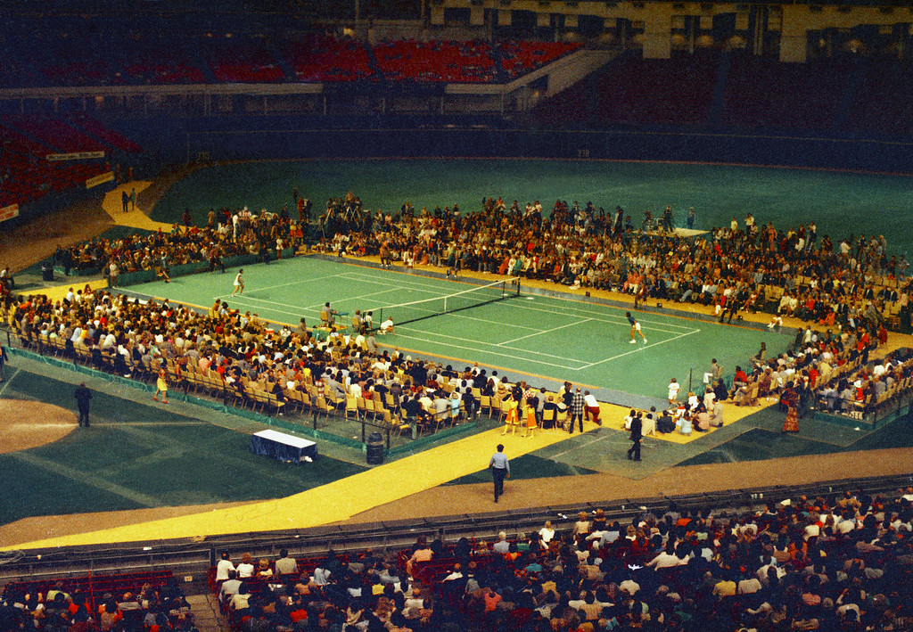 ". Tennis star Bobby Riggs, right side, and Billie Jean King are shown in action during the ""Battle of the Sexes\"" match in the Astrodome in Houston, Tex., Sept. 20, 1973.  (AP Photo)"