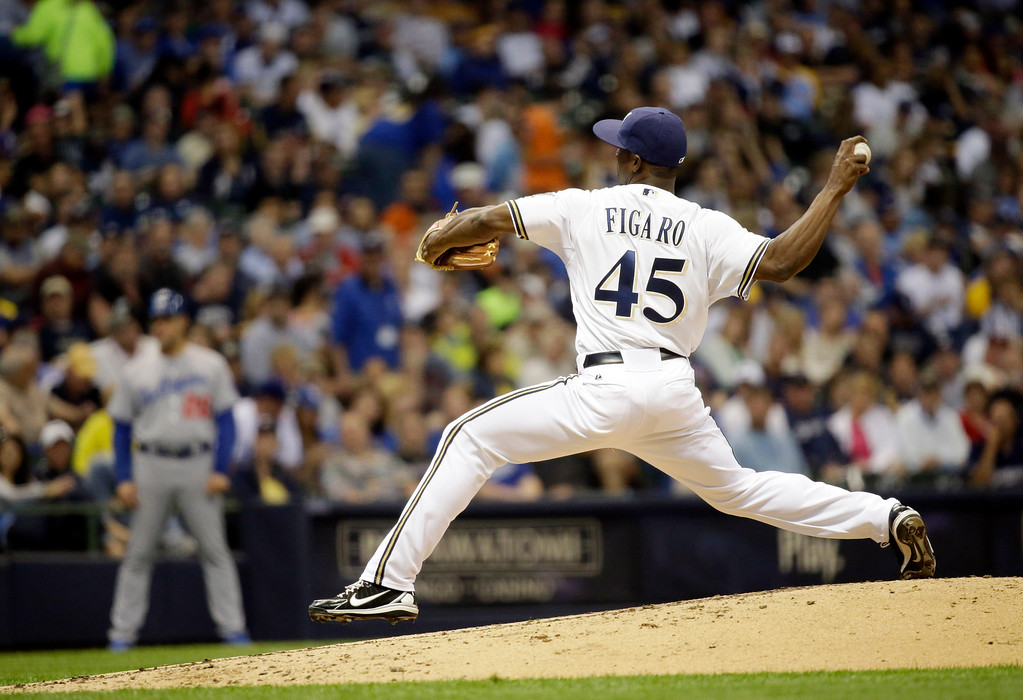 . Milwaukee Brewers relief pitcher Alfredo Figaro throws during the third inning of a baseball game against the Los Angeles Dodgers Wednesday, May 22, 2013, in Milwaukee. (AP Photo/Morry Gash)