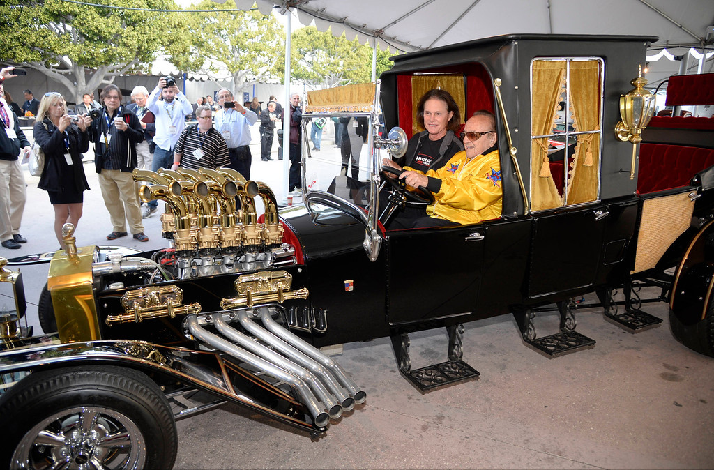 . Famous car designer Chuck Barris sits with former olympic metal runner Bruce Jenner in the TV\'s series The Monsters hurst hot rod, during the first media day during the LA auto show, as the show will open to the public this Friday.  Nov 20,2013. Photo by Gene Blevins/LA Daily News