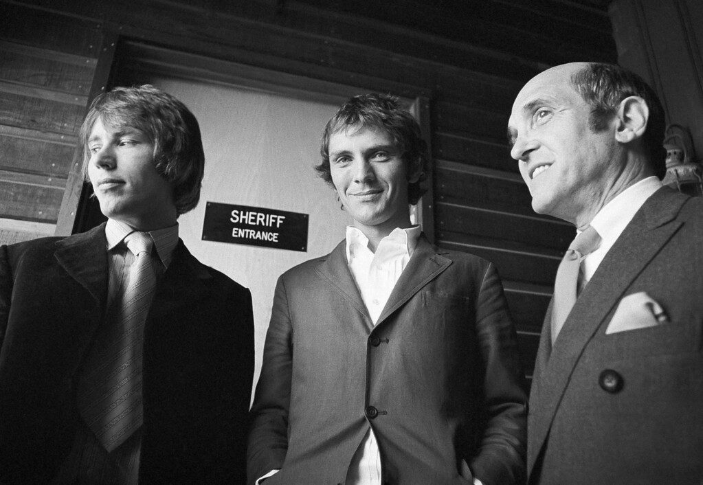 . British actor Terence Stamp, right, and his younger Christopher wait in Malibu Justice court for their arraignment on a charge of possession of marijuana in Malibu, Calif. on May 23, 1968. They were arrested after officers said they found marijuana in their car on a street near Malibu. (AP Photo/George Brich)