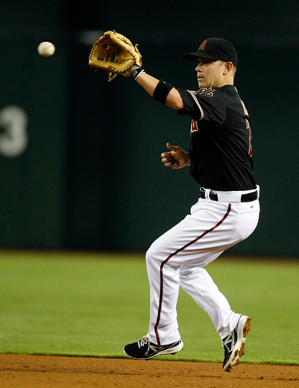 . Arizona Diamondbacks second baseman Aaron Hill  makes the play for the out in the fifth inning during a baseball game against the Los Angeles Dodgers on Monday, July 8, 2013, in Phoenix. (AP Photo/Rick Scuteri)
