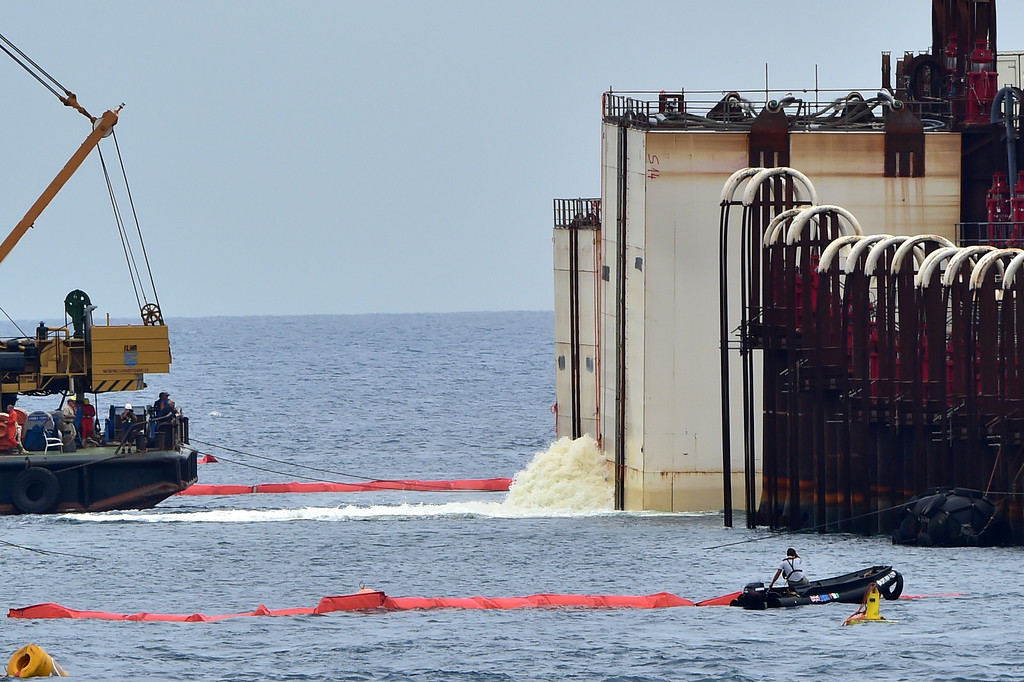 . Water is expelled from caissons hooked on the wreck of the Costa Concordia cruise ship during an operation to refloat the boat on July 14, 2014 off the Giglio Island. Over two and a half years after it crashed off the island of Giglio in a nighttime disaster which left 32 people dead, the plan is to raise and tow away the 114,500-tonne vessel in an unprecedented and delicate operation for its final journey to the shipyard where it was built in the port of Genoa.             (GIUSEPPE CACACE/AFP/Getty Images)