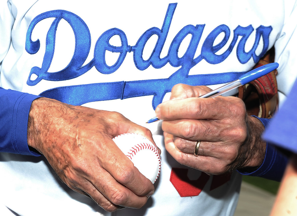 . Former Los Angeles and Brooklyn Dodger left handed pitcher Sandy Koufax signs Atlanta Braves\' Craig Kimbrel (not pictured) baseball during the Old-Timers game prior to a baseball game between the Atlanta Braves and the Los Angeles Dodgers on Saturday, June 8, 2013 in Los Angeles.   (Keith Birmingham/Pasadena Star-News)