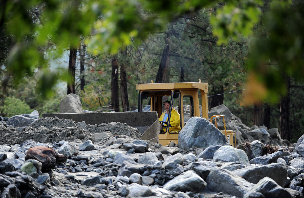 . Clean up continues after Sunday\'s storm caused flooding on Monday, August 4, 2014 in Forest Falls, Ca. (Micah Escamilla/San Bernardino Sun)