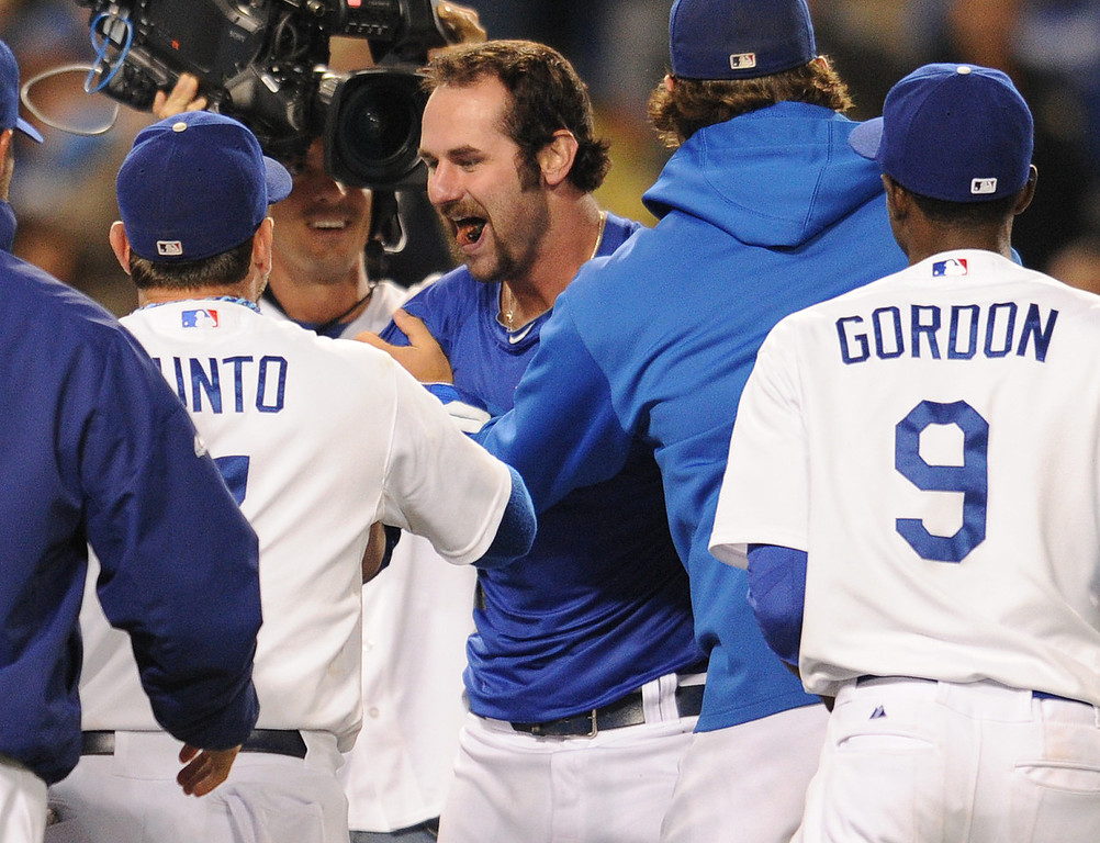 . Scott Van Slyke reacts to his team mates ripping his jersey off his back. The Dodgers defeated the Arizona Diamondbacks 5-3 after Scott Van Slyke hit a 2 run walk off homer in the 11 inning at Dodger Stadium in Los Angeles, CA. 9/10/2013. photo by (John McCoy/Los Angeles Daily News)