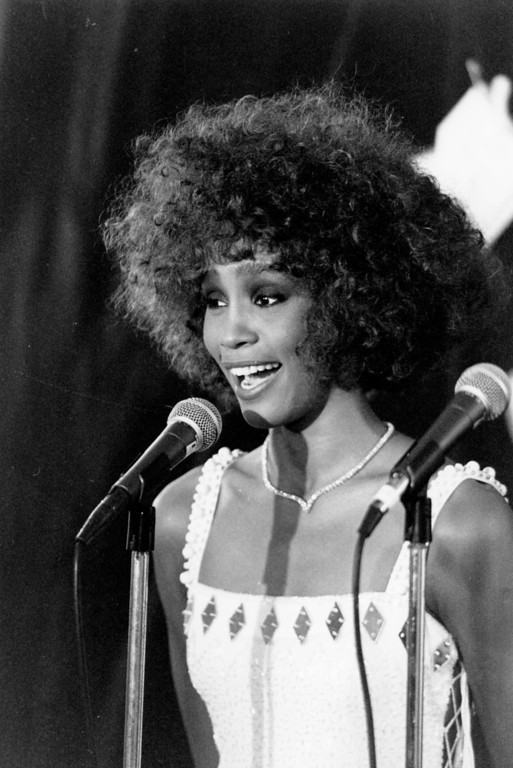 . American singer Whitney Houston talks to the press following the third annual MTV Music Video Awards ceremony in Los Angeles, Ca. on Sept. 5, 1986.  (AP Photo/Mark Avery)