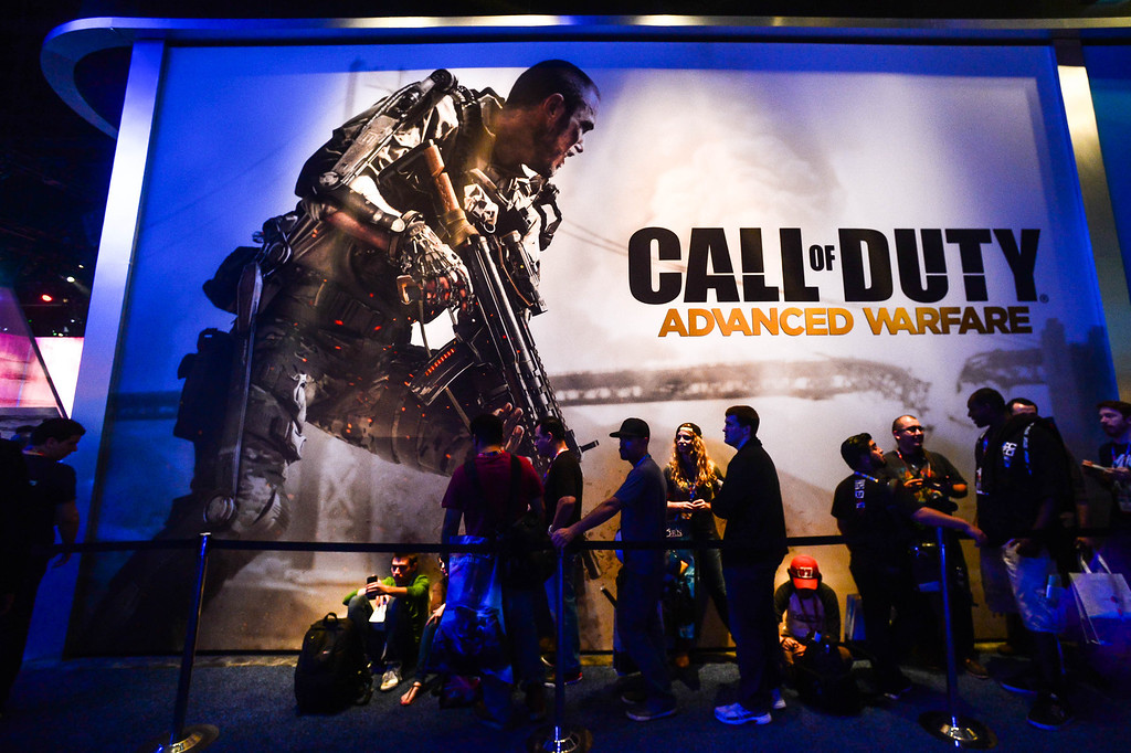 """. Attendees wait in line at the \""""Call of Duty\"""" game booth at Electronic Entertainment Expo in Los Angeles on Tuesday, June 10, 2014. (Photo by Watchara Phomicinda)"""