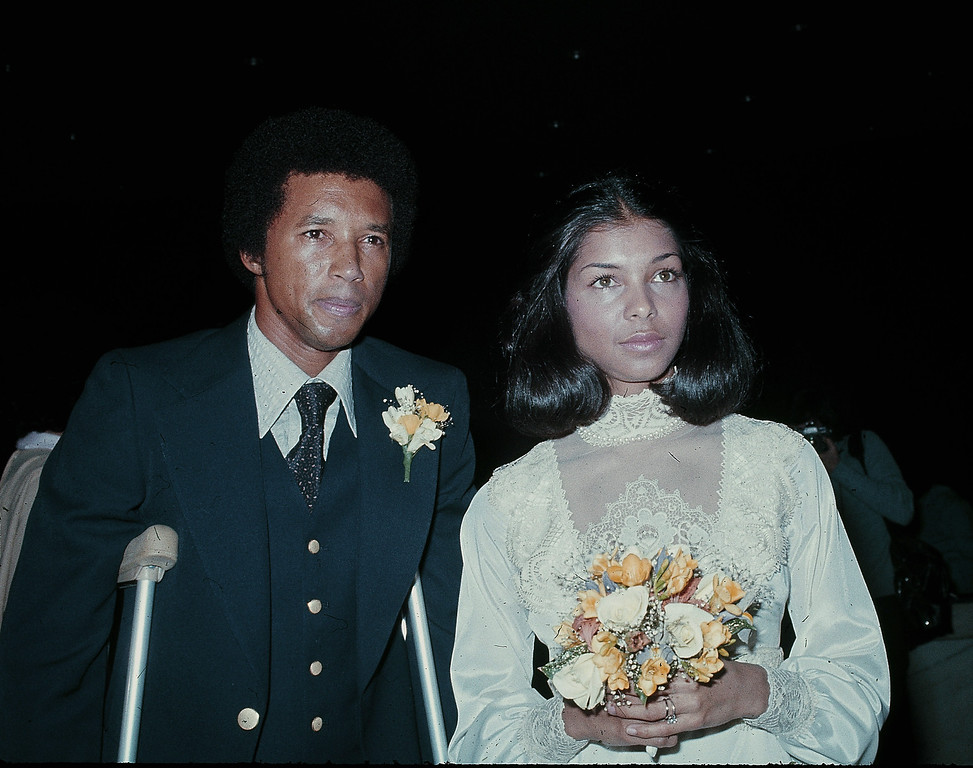 . Tennis star Arthur Ashe and his wife Jean Moutoussamy are shown on their wedding day, Feb. 20, 1977.  (AP Photo)