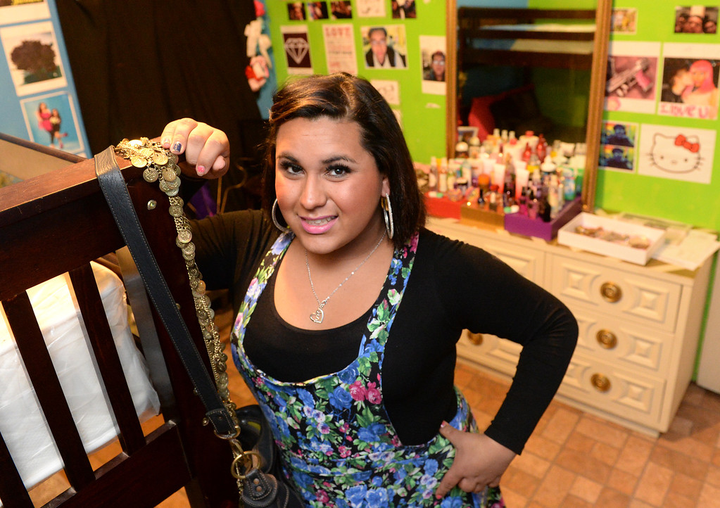 . Transgender student, Staceyy Holidayy, 15, who received a two-day suspension on Wednesday for a dress code violation at El Rancho High School in Pico Rivera, Calif., stands in her room on Friday January 10, 2014. Holidayy, formerly Roberto Valencia, was told that she was not allowed to use the girl\'s restroom but had to use the restroom in the nurses office. (Staff Photo by Keith Durflinger/Whittier Daily News)