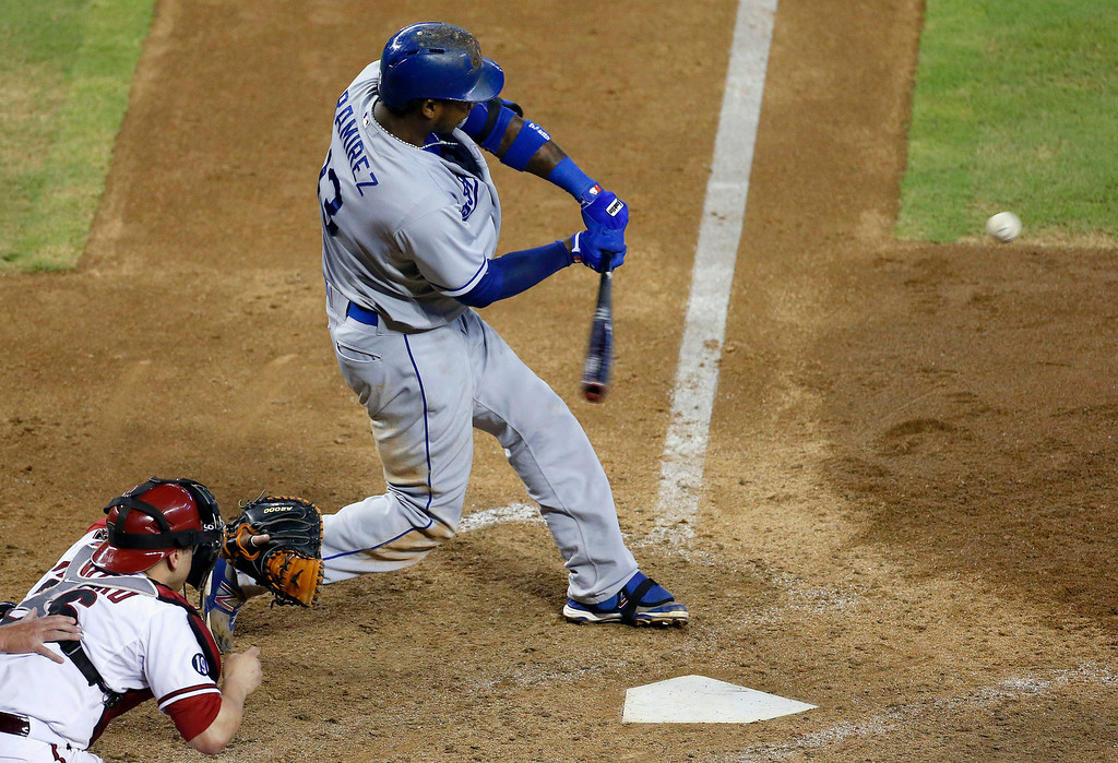 . Los Angeles Dodgers\' Hanley Ramirez, right, connects for a home run as Arizona Diamondbacks\' Miguel Montero looks on in the seventh inning of a baseball game on Thursday, Sept. 19, 2013, in Phoenix. (AP Photo/Ross D. Franklin)