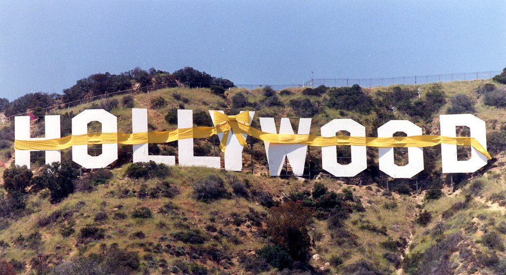 ". The Hollywood sign in the hills is bedecked with a yellow ribbon in preparation for the ""Welcome Home Desert Storm Parade.\""  6/1/91 (L.A. Daily News file photo)"