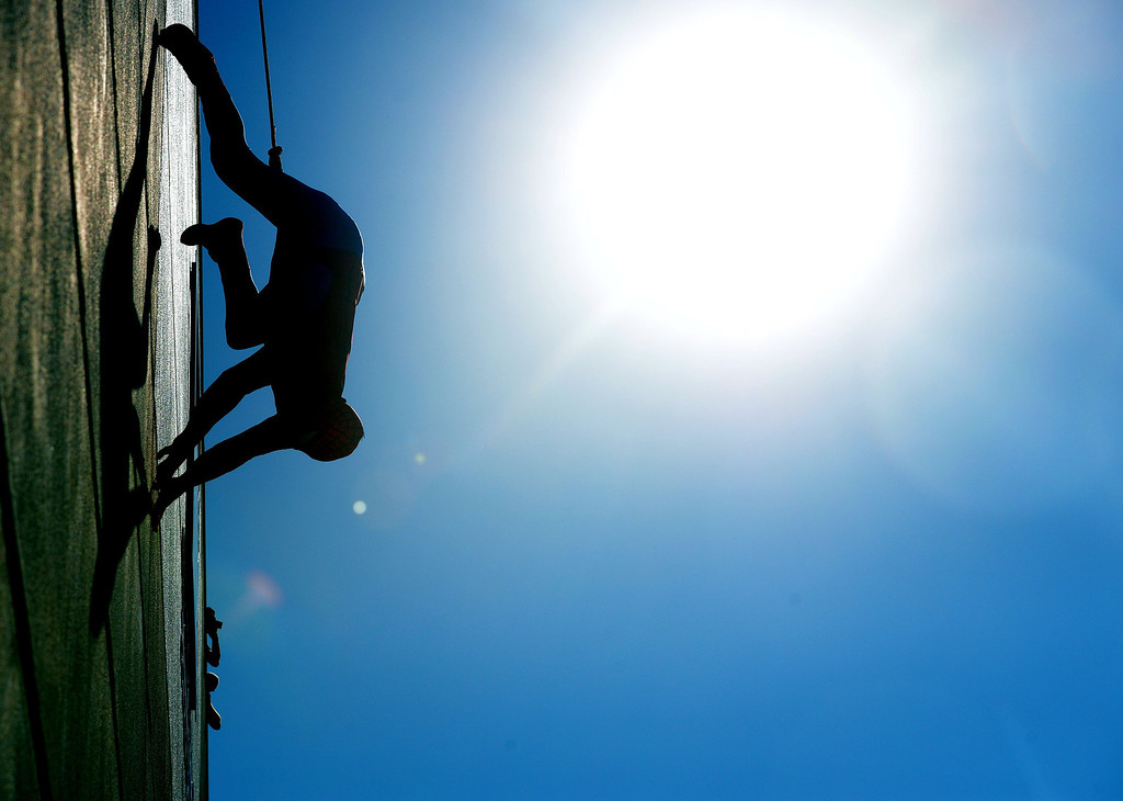 . (Will Lester/Inland Valley Daily Bulletin) Spiderman repels down the side of the Ontario Convention Center Thursday.  Jacob Long, 5 from Mira Loma, dream of fighting along side his favorite superhero, Spiderman, came true Thursday August 22, 2013 by the Make-A-Wish Orange County/Inland Empire along with assistance from the Ontario police and fire departments. At 15 months Jacob was diagnosed with an immune deficiency disease and has had to have 2 bone marrow transplants to cure it.
