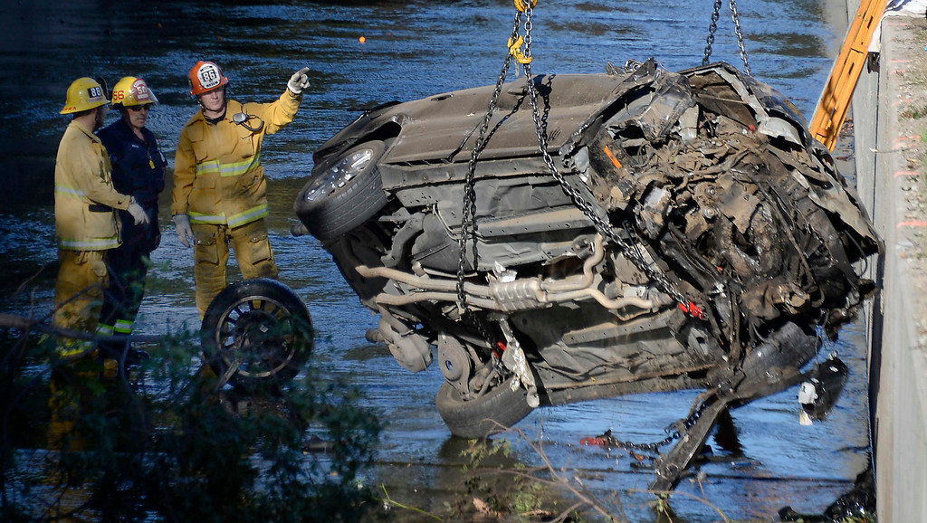 . LA city firefighters at the scene were one person was found dead this morning inside a vehicle in the Tujunga Wash in the Toluca Lake area, authorities said. The body, tentatively identified as a 31-old-male driver from Woodland Hills, was discovered about 7:15 a.m. near the 4300 block of Vineland Avenue, the Los Angeles Fire Department reported.  Investigators were working to determine how the vehicle ended up on its side in the wash, which is near the northbound Hollywood (101) Freeway. Jan 2,2014. Photo by Gene Blevins/LA Dailynews