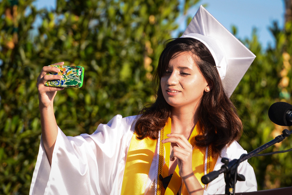 """. Kennedy High school valedictorian Andrea Rodriguez snaps a \""""selfie\"""" before delivering her speech to fellow graduates at graduation ceremonies Thursday, June 5, 2014.   ( Photo by David Crane/Los Angeles Daily News )"""
