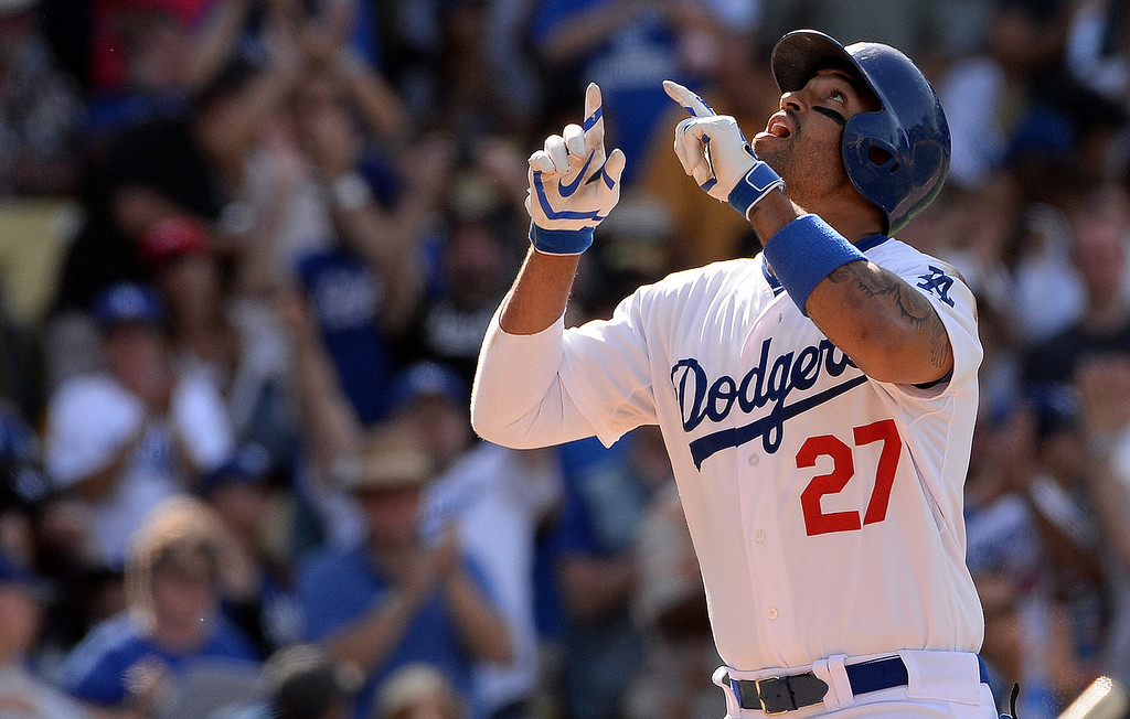 . Los Angeles Dodgers\' Matt Kemp points to the sky after hitting a solo home run in the eighth inning during a Major league baseball game against the San Francisco Giants on Saturday, May 10, 2013 in Los Angeles.   (Keith Birmingham/Pasadena Star-News)
